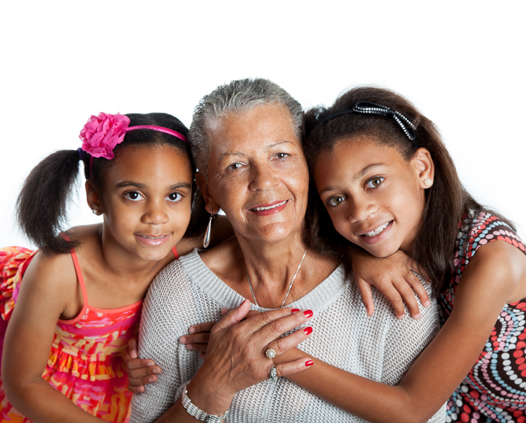 Grandmother and granddaughters embracing